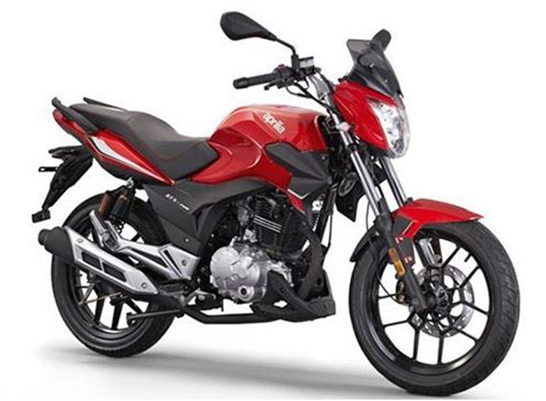 STX 150 Road is the cheapest Aprilia bike in Nepal. The 150cc engine commuter looks pretty stylish for a commuter, maybe that's Aprilia's standard for a commuter! Likewise, Aprilia STX 150 Road is the most economical choice among the Aprilia bikes price in Nepal. This entry-level brand luxury gives good competition to the likes of Suzuki Gixxer and Yamaha FZ 150 segments! Specifications Displacement: 149 cc Engine Type: Single Cylinder, 4 Stroke Max Power: 22 hp @ 10500 rpm Max Torque: 16 Nm @ 8250 rpm Gearbox: 5 Front Suspension: 37mm Hydraulic Forks Rear Suspension: 2 Hydraulic Monoshock Absorber with separate canisters Front Tire: 90/90-17 Rear Tire: 90/90-17 Seat Height: 870 mm Fuel Capacity: 18 liters Aprilia STX 150 (Road) price in Nepal is Rs. 2, 79,000. Related: Suzuki Bikes Price in Nepal Aprilia ETX 150 Enduro