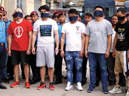 Five Chinese hackers whom were arrested for stealing millions of rupees from various ATM booths are displayed to the media inside the Police Station in Kathmandu on Sunday. Photo/Skanda Gautam/ THT